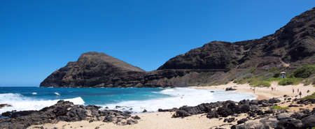 Makapuu Beach Panoramic - Boogie board spot number one for the island of Oahu, Makapuu Beach is one of the more rugged beach parks on the island. The lighthouse at the end of Makapuu point is one of the last fully functioning lighthouses in America.  Th photo