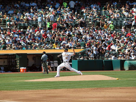 Red Sox vs. As: Dallas Braden throws pitch from mound.  September 12 2010 Coliseum Oakland California