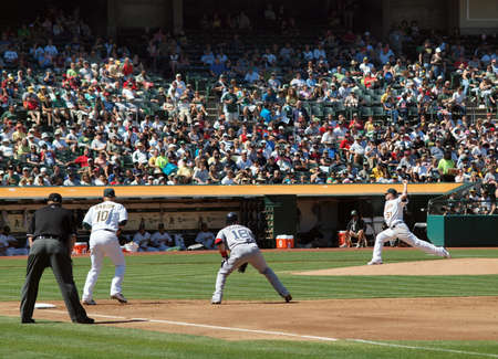 Red Sox vs. As: Mark Scutaro takes lead as Dallas Bredan throws pitch.  September 12 2010 Coliseum Oakland California