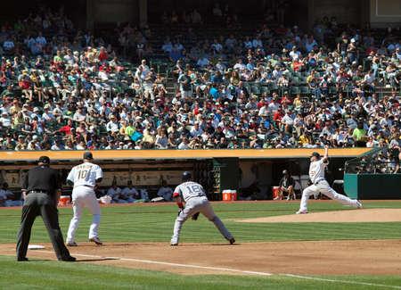 Red Sox vs. As: Mark Scutaro takes lead as Dallas Bredan throws pitch.  September 12 2010 Coliseum Oakland California