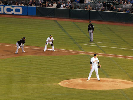 cahill: White Sox vs. Athletics: As Trevor Cahill stands on mound with White Sox Manny Ramirez taking lead at 1st base during a night game. Taken on September 21 2010 at Coliseum in Oakland California.