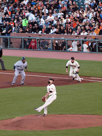 outfielders: Brewers vs. Giants: Brewers Prince Fielder takes lead at 1st as Giants Tim Lincecum steps into a throw.  September 18 2010 at the ATT Park San Francisco California.