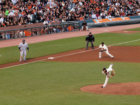 Brewers vs. Giants: Brewers Prince Fielder taking lead from 3rd as Giants Tim Lincecum throws pitch.  September 18 2010 at the ATT Park San Francisco California. Stock Photo - 7863799