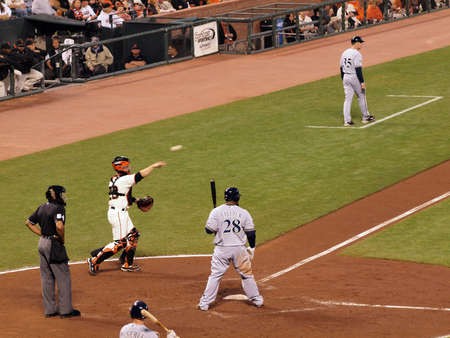 outfielders: Brewers vs. Giants: Giants Catcher Buster Posey throws ball back to pitcher during a pitch out to Brewers Prince Fielder.  September 18 2010 at the ATT Park San Francisco California.