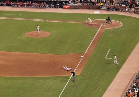 baseman: Diamondbacks vs. Giants: Diamondback 3rd baseman Tony Abreu makes diving catch from hit of Giants Buster Posey. taken on September 28 2010 at Att Park in San Francisco California.