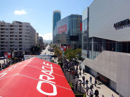 people walking though a busy Oracle Open World Convention 2010 on the whole block of Howard street and the Moscone Center. September 22 Moscone Center San Francisco.