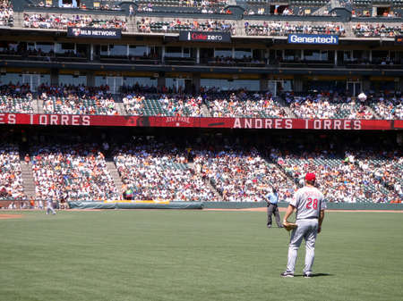 Reds vs. Giants: Reds Outfielder Chris Heisey stands in right field in between plays.  August 25 2010 at the ATT park San Francisco California. Stock Photo - 7863862