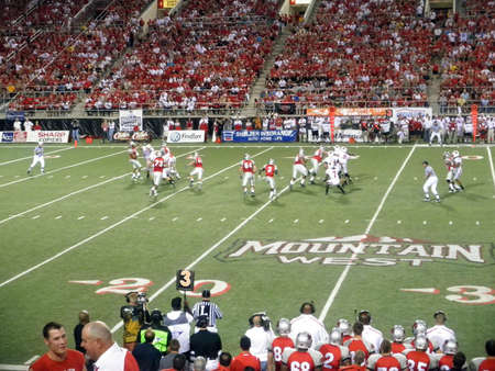 Wisconsin vs. UNLV: UNLV Quarterback in motion to throw ball with defender trying to block throw.  Taken September 4 2010 at Sam Boyd Stadium Las Vegas, Nevada. Stock Photo - 7863893