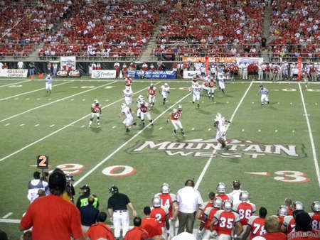 Wisconsin vs. UNLV: UNLV player holding football tries to get past Wisconsin defense.  Taken September 4 2010 at Sam Boyd Stadium Las Vegas, Nevada.