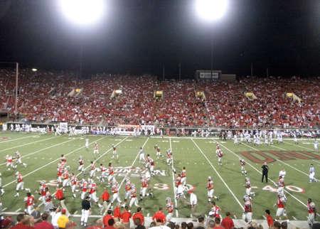 Wisconsin vs. UNLV: College Football players run to lockers at half-time.  Taken September 4 2010 at Sam Boyd Stadium Las Vegas, Nevada.