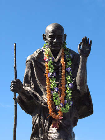 Statue of Mahatma Ghandi wearing real leis My life is My Message Who lived October 2, 1869 - January 30, 1948, at the Ferry Building, San Francisco, California.  By Sculptors Zlatko Pounov and Steven Lowe, Dedicated October 3, 1988 by SF Mayor Art Agnos