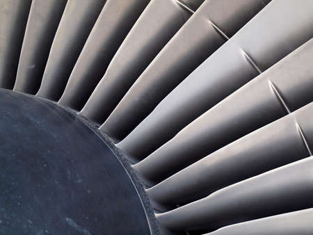 Close up of turbine and blades of a jet engine.