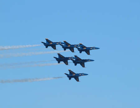 SAN FRANCISCO - OCTOBER 10: Six Blue Angels fly in tight triangle formation as afterburns fire taken October 10, 2010 San Francisco. Stock Photo - 8151266