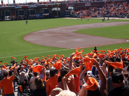 Padres vs. Giants: Fans wave orange towels to pump up team before the start of the game.  taken on October 2 2010 at Att Park in San Francisco California.