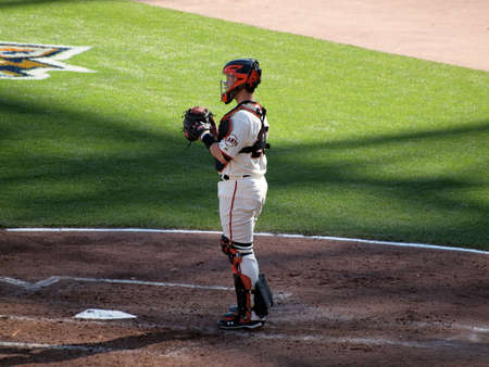 SAN FRANCISCO, CA - OCTOBER 19: San Francisco Giants vs. Philadelphia Phillies:Catcher Buster Posey stands in catcher gear in between innings game three of the NLCS 2010 taken October 19, 2010 AT&T Park San Francisco California.
