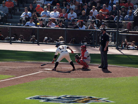 ruiz: SAN FRANCISCO, CA - OCTOBER 19: San Francisco Giants vs. Philadelphia Phillies: Giants Cody Ross at bat taps bat on plate with Carlos Ruiz catching game three of the NLCS 2010 taken October 19, 2010 AT&T Park San Francisco California.
