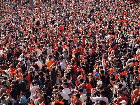 baseball crowd: SAN FRANCISCO, CA - OCTOBER 19: San Francisco Giants vs. Philadelphia Phillies: Giants fans wave orange rags and cheer to rally team game three of the NLCS 2010 taken October 19, 2010 AT&T Park San Francisco California.