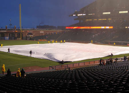 SAN FRANCISCO - APRIL 11: Braves Vs. Giants: Giants grounds crew uses tarp to cover infield to save it from rain after Giants win game April 11 2010 at Att Park San Francisco California.