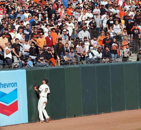 ca he: SAN FRANCISCO, CA - JULY 28: San Francisco Giants Vs. Florida Marlins: Aubrey Huff presses into the wall as he Watches a home run fly over his head in left field at AT&T Park July 28, 2010 in San Francisco, California.