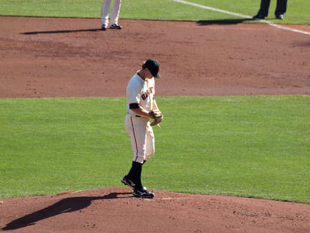 ca he: SAN FRANCISCO, CA - OCTOBER 19: San Francisco Giants vs. Philadelphia Phillies: Pitcher Matt Cain looks down as he prepares to pitch game three of the NLCS 2010 taken October 19, 2010 AT&T Park San Francisco California.