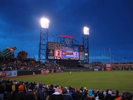SAN FRANCISCO - APRIL 11: Braves Vs. Giants: Giants outfielders chase after homerun ball by Braves Hitter Jason Heywward at dusk taken April 11 2010 at Att Park San Francisco California. Editorial