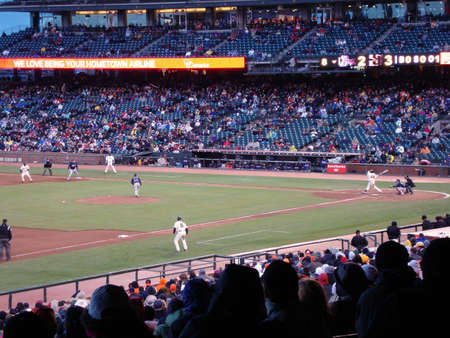 SAN FRANCISCO - APRIL 11: Braves Vs. Giants: Giants Pablo Sandoval hits homerun with runner Edger Renteria taking lead on first after a rain delay taken April 11 2010 at Att Park San Francisco California.