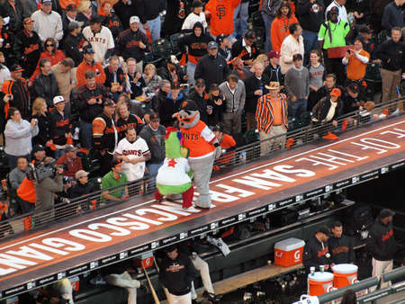 SAN FRANCISCO, CA - OCTOBER 20: San Francisco Giants vs. Philadelphia Phillies: Philadelphia Phillies Phanatic vs. San Francisco Giants Lou Seal Mascot fight on top of the Dugout during innings game four of the NLCS 2010 taken October 20, 2010 AT&T Park S