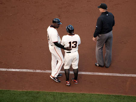 ca he: SAN FRANCISCO, CA - OCTOBER 20: San Francisco Giants vs. Philadelphia Phillies:Coach Roberto Kelly talks to player Cody Ross on 1st base line after he was hit by a pitch game four of the NLCS 2010 taken October 20, 2010 AT&T Park San Francisco California. Editorial