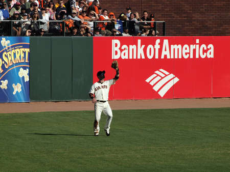 orioles: SAN FRANCISCO, CA - JULY 28: Giants Vs. Marlins: Giants Aaron Rowand opens glove to catch ball in the outfield July 28, 2010 ATT Park San Francisco California.