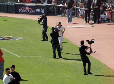 SAN FRANCISCO, CA - OCTOBER 19: San Francisco Giants vs. Philadelphia Phillies: Pitcher Tim Lincecum runs toward camera as hes introduced before start of game three of the NLCS 2010 taken October 19, 2010 AT&T Park San Francisco California.