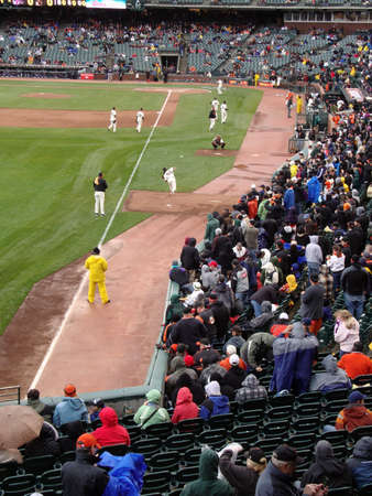 Braves Vs. Giants: Giants pitcher Tim Lincecum throws a pitch to Bengie Molina in bullpen after a rain delay.  Ball seen flying in the air.  taken April 11 2010 at Att Park San Francisco California.