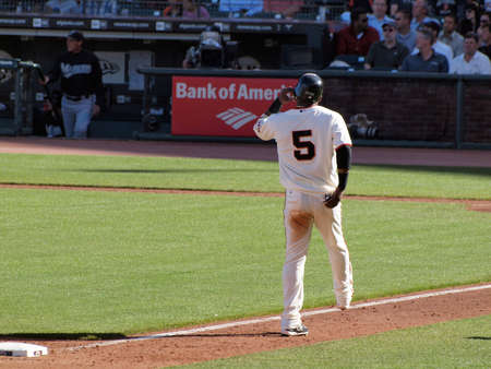 ca he: SAN FRANCISCO, CA - JULY 28: San Francisco Giants Vs. Florida Marlins: Giants Juan Uribe walks past third as he begins to lift his helmet at the end of inning AT&T Park July 28, 2010 in San Francisco, California.