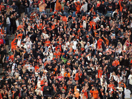 baseball crowd: SAN FRANCISCO, CA - OCTOBER 20: San Francisco Giants vs. Philadelphia Phillies:Giants fans go crazy for hit to help with mid-game rally of game four of the NLCS 2010 taken October 20, 2010 AT&T Park San Francisco California.  Editorial