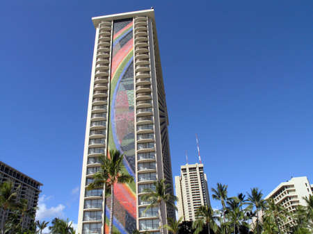 HONOLULU, HI - JUNE 22: Waikiki Rainbow Tower is a 31-story tower is recognized as an Oahu landmark for the two mosaic tile rainbows on either side of the building. The mosaics are listed in the Guinness Book of World Records for being two of the world's  Stock Photo - 8151315