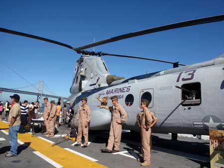 SAN FRANCISCO - OCTOBER 10: Marines display heavy duty helicopter to civilians on the deck of the USS Makin Island during Fleet Week Taken October 10 2010 in San Francisco.