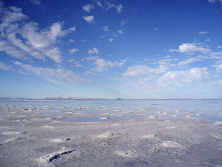 Salt fields slowly giving way into the the Great Salt Lake, Utah with stretching sky during the late summer. Stock Photo - 8306290