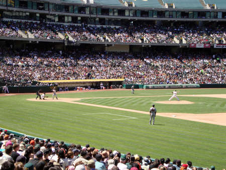 oakland: OAKLAND, CA - MAY 23: San Francisco Giants Vs. Oakland Athletics: As Michael Wuertz steps forward to throw pitch to Aaron Rowand May 23 2010 at Coliseum Oakland California.