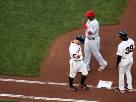 ca he: SAN FRANCISCO, CA - OCTOBER 20: Cody Ross reaches out arm as he walks to 1st base after he was hit by a pitch game 4 of the 2010 NLCS between Giants and Phillies Oct. 20, 2010 AT&T Park San Francisco, CA.
