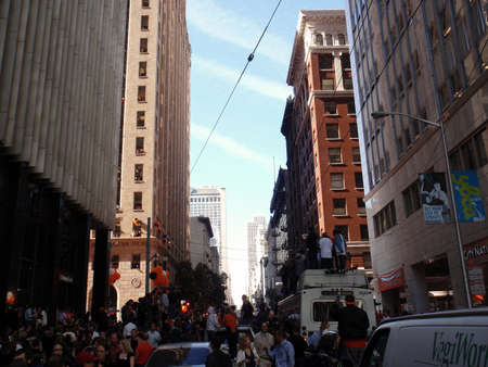 SAN FRANCISCO, CA - NOVEMBER 3: Giants fans stand on anything they can and celebrate the parade as confetti falls from the sky  Nov. 3, 2010 San Francisco, CA.