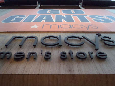 macys: SAN FRANCISCO, CA - NOVEMBER 2: Go Giants Sign hung on Macys Mens Store to honor Giants Playoff run Nov. 2, 2010 Union Square San Francisco, CA.  Editorial