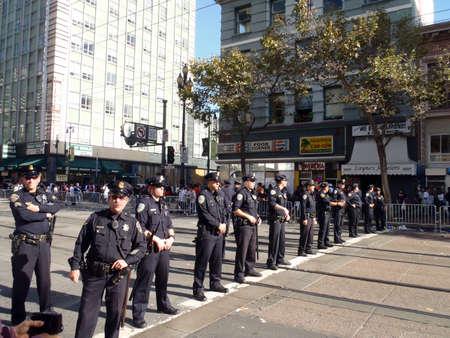 SAN FRANCISCO, CA - NOVEMBER 3: Police officers stand in line across market street Nov. 3, 2010 San Francisco, CA.