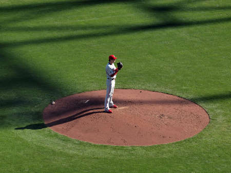 SAN FRANCISCO, CA - OCTOBER 19: Giants vs. Phillies: Philles Cole Hamels stands on mound lifting glove up towards face as he prepares to pitch game three of the NLCS 2010 taken October 19, 2010 AT&T Park San Francisco.