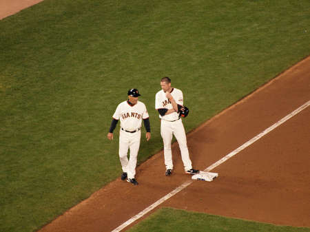 SAN FRANCISCO, CA - OCTOBER 20: Giants Aubrey Huff talks to 3rd base coach Tim Flannery at 3rd base between plays with his helmet off game 4 of the 2010 NLCS game between Giants and Phillies Oct. 20, 2010 AT&T Park San Francisco, CA.