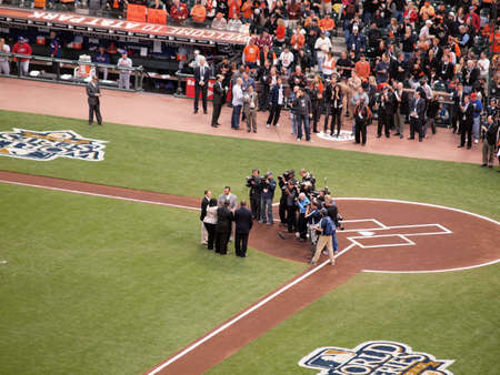 SAN FRANCISCO, CA - OCTOBER 28: Camera crews film as Tim Wakefield shakes hands with the Clemente Family as he accepts Roberto Clemente award before the start of game 2 of the 2010 World Series game between Giants and Rangers Oct. 28, 2010 AT&T Park San F