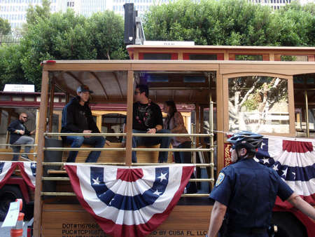 SAN FRANCISCO, CA - NOVEMBER 3: Giants prepare for start of world championship parade with Tim Lincecum and dan runzler sitting in trolly car as Cody Ross passes in the background as his car takes off Nov. 3, 2010 San Francisco, CA.