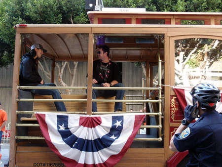 SAN FRANCISCO, CA - NOVEMBER 3: Giants prepare for start of world championship parade with Tim Lincecum and dan runzler sitting, talkng and smiling in trolly car Nov. 3, 2010 San Francisco, CA.