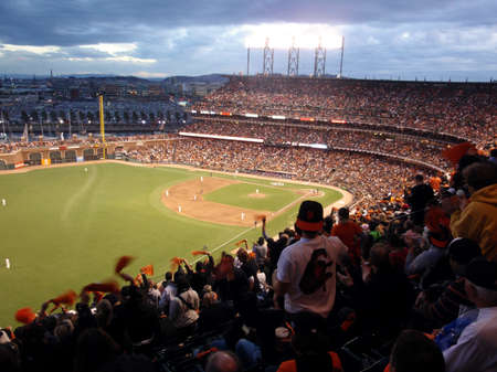 SAN FRANCISCO, CA - OCTOBER 28: Giants fans cheer waving rags in anticipation of upcoming pitch game 2 of the 2010 World Series game between Giants and Rangers Oct. 28, 2010 AT&T Park San Francisco, CA.