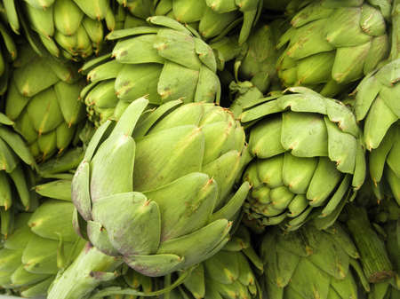 Pile of Artichoke on display at a farmers market in San Francisco, CA photo