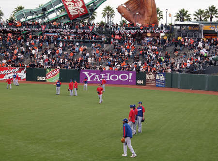 outfield: SAN FRANCISCO, CA - OCTOBER 28: Rangers players taking balls in the outfield during batting practice game 2 of the 2010 World Series game between Giants and Rangers Oct. 28, 2010 AT&T Park San Francisco, CA.  Editorial
