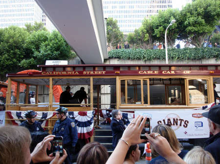 SAN FRANCISCO, CA - NOVEMBER 3: Giants fans take photos with Smart Phones of players on Trolley Car before the start of the 2010 Giants World Championship Parade with fans waving and taking photos Nov. 3, 2010 San Francisco, CA.